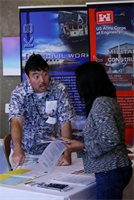 Honolulu District contracting officer Kent Tamai mans the District's booth during the 10th Annual DoD Hawai'i Small Business Forum held at the Honolulu Country Club on Thursday, July 12, 2012.